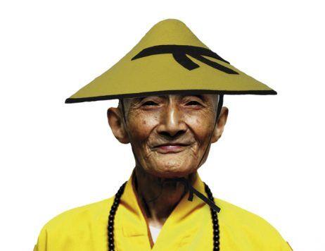 Chapeau jaune et noir conique asie